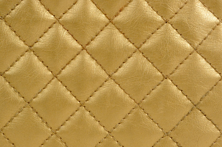 quilted: Golden Quilted Leather Background Stock Photo
