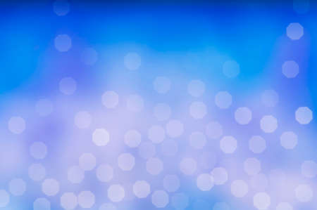 Christmas and New Year holidays blurred blue sparkles background, abstract background with bokeh defocused glittering lights and shadow.