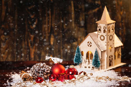 Stylish Rustic Winter Wallpaper With Pine Cones Baubles And Wooden Church Photo