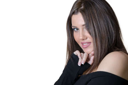 hand wear: Cute brunette lady wear strapless shirt, looking at the camera with her hand under her chin
