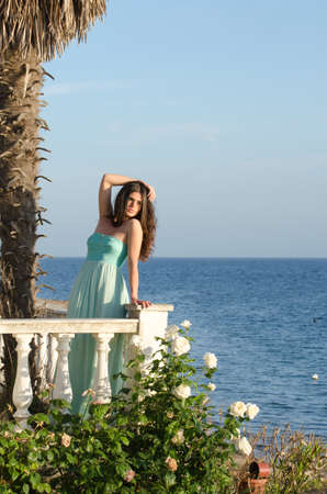 beachfront: Beautiful veranda of a beachfront home with stylish white balustrades and palm trees