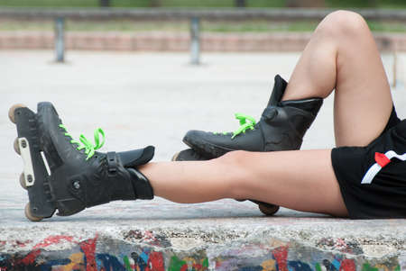 roller: Young female legs with roller skates