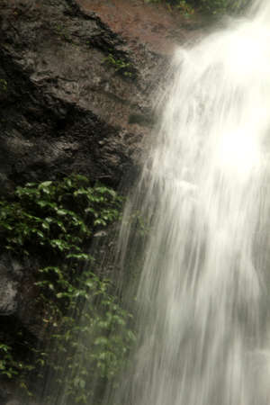 water accelorating  down cliff photo