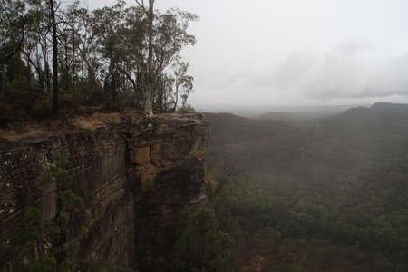 Dark and gloomy cliff photo