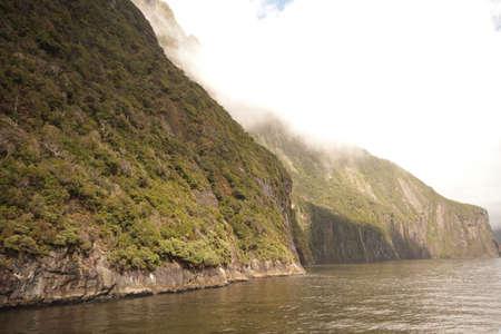 neroyfjord: Mountain cascading down lake