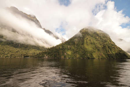neroyfjord: Milford sound, disappearing into the coulds