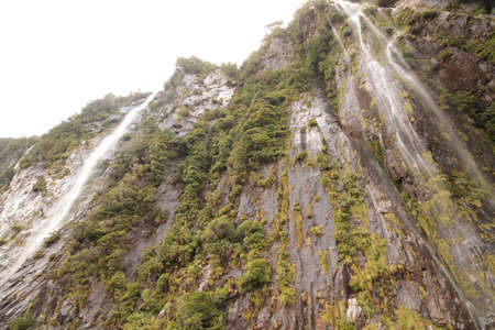 Twin waterfalls over cliff face photo
