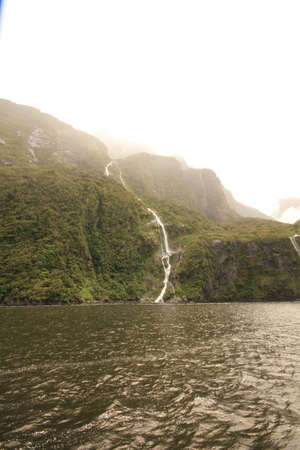 neroyfjord: Waterfall falling down into lake
