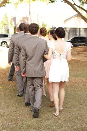 Bridal Party walking down the aisle Stock Photo