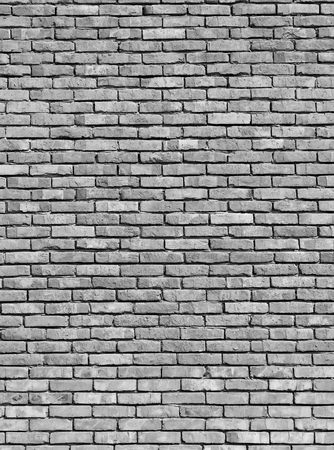 Old monochrome brick wall texture background