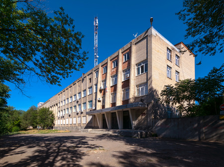 Soviet modern era brutalism style industrial building in sunny summer day in Rostov-on-Don, Russia