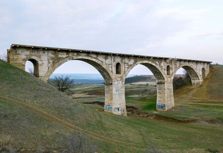 Old railway viaduct ruined bridge Veselovskiy in steppe between Stavropol and Armavir, Russia 版權商用圖片
