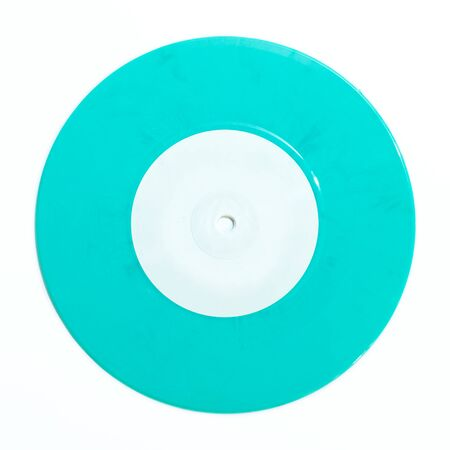 Seven inch single 45rpm blue green vinyl record with small hole isolated on white background