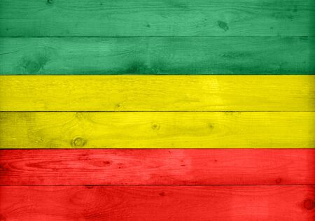 Wooden surface texture fence panel planks background in rasta reggae ethiopian flag colors 版權商用圖片