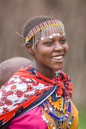 maasai mara: Maasai Woman carrying baby