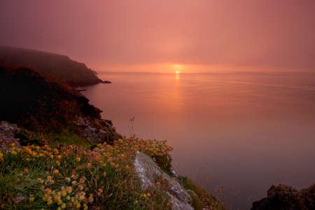 pembrokeshire: Misty sunset, Pembrokeshire, Wales Stock Photo