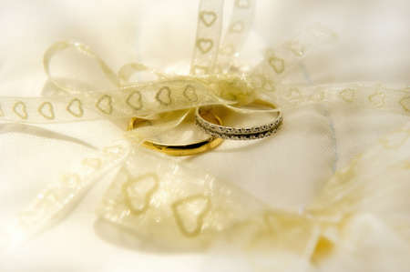 Wedding Rings on silk cushion photo
