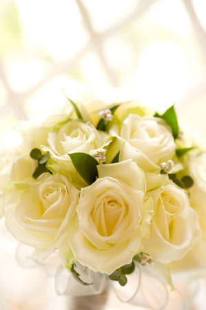 latticed: Wedding bouquet against latticed windows