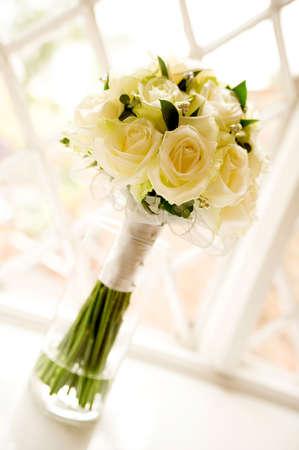 Wedding bouquet against latticed windows