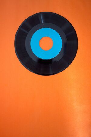 rpm: vintage 45 rpm record on an orange background
