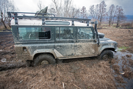 quicksand: offroad car in the mud Stock Photo