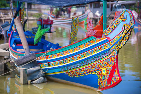 Colorful traditional fisherman boats in Kelantan, Malaysia Traditiona l fishing village, a rendezvous for fishing boats with intricate design