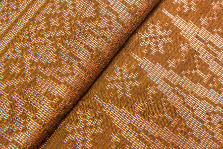 Malaysia Songket  Songket is a fabric that belongs to the brocade family of textiles of Indonesia, Malaysia and Brunei  It is hand-woven in silk or cotton  photo