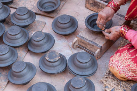 hands of potter do a clay pot in Bhaktapur, Nepal