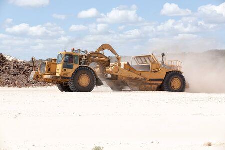 Scrapper working moving sand on new Australian coastal suburb