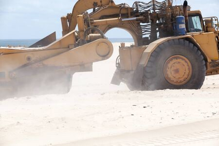 Scrapper working moving sand on new Australian coastal suburb Stock Photo - 77092586