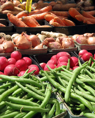 peasant farming: A table full of colorful local produce for sale at a farmers market. Stock Photo