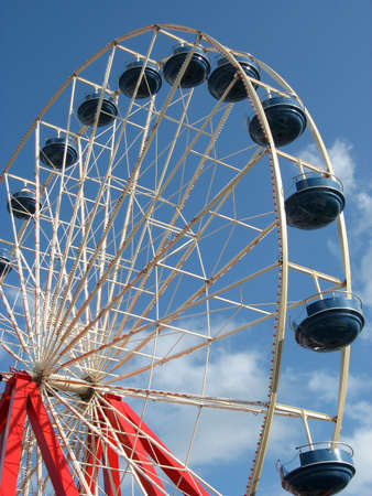 a giant Ferris wheel stands against a brilliant blue sky background on summer day. Stock Photo - 7272958