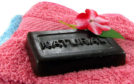 A bar of natural, organic soap rests on a pile of fresh, clean washcloths. Stock Photo - 8256659