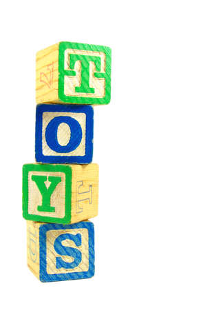 A tower of alphabet blocks spelling out the word
