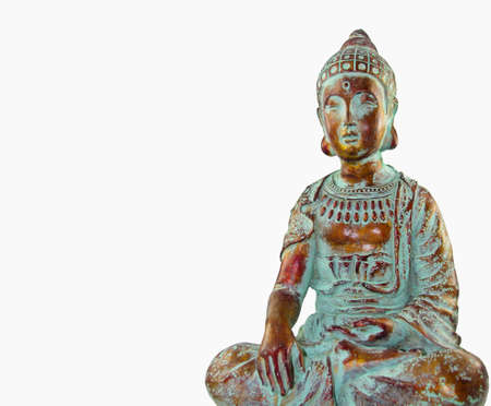 Copper colored Buddha statue sitting in lotus isolated on white.