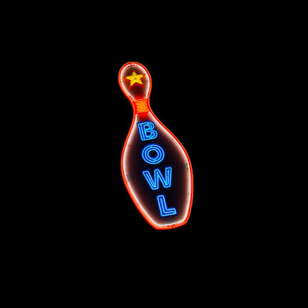 bowling alley: A glowing neon sign featuring a bowling pin with the word  Stock Photo