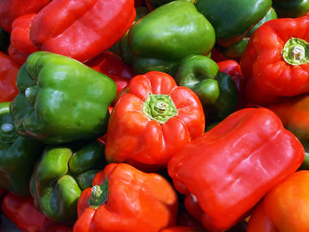 Fresh, crisp green and red bell peppers for sale at local farmer