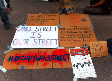 New York - September 21: Political messages are taped to the ground on the plaza at Zuccotti Park during the  Occupy Wall St. demonstration near the New York Stock Exchange on September 21, 2011 in New York City.