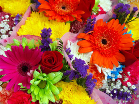 A vibrant, multi-colored collection of flower bouquets. photo