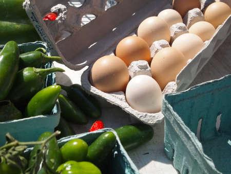 A carton of fresh brown eggs for sale on a farmer photo