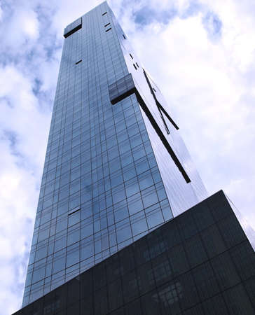 Looking up into the sky towards the top of an extremely tall building.