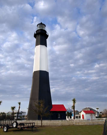 The historic lighthouse on Tybee Island, GA is an attractive tourist destination  Editorial