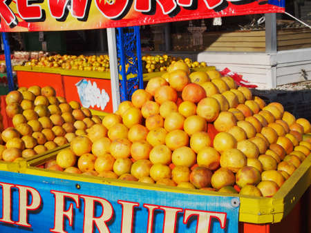roadside stand: A roadside stand displays mountains and bins of brightly colored fresh citrus fruits for sale in the southern United States.