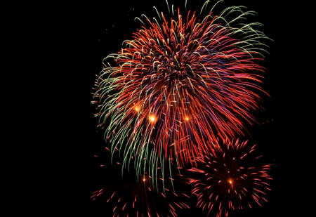 Multi-colored fireworks bursting against the background of a black night sky. Stock Photo - 24954816
