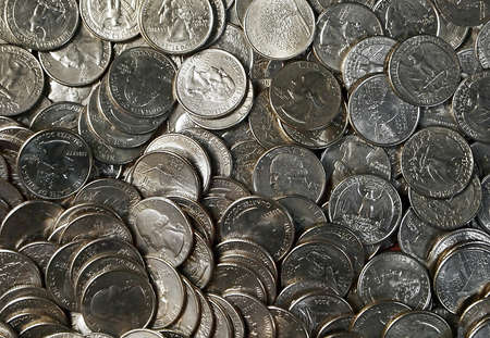 25 cents: A tray full of American quarters laid out flat for a money themed background image  Stock Photo