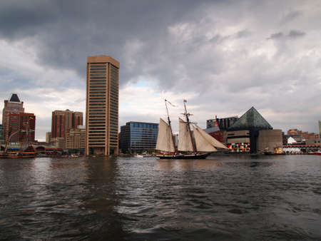 BALTIMORE, MD -  SEPTEMBER 11, 2014: Tall ship Lynx, from Portsmith, NH, takes an evening sail through Baltimores Inner Harbor during the Star Spangled Spectacular which celebrates the 200th anniversary of Americas National Anthem.