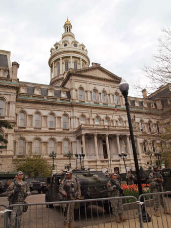 md: BALTIMORE, MD - MAY 1, 2015: The National Guard surrounds the City Hall  building in Baltimore, MD, on May 1, 2015, during a week of citizen protests and riots against police brutality.