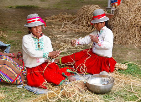 WASHINGTON, DC - JULY 1: Two Peruvian women demonstrate the tradition of braiding grass into rope at the Smithsonian Folklife Festival on July 1, 2015, in Washington, D.C. Editorial