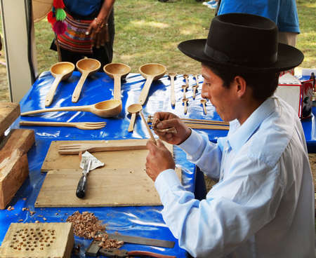 WASHINGTON, DC - JULY 1: A Peruvian man finishes wooden kitchen utensils with carving tools and sandpaper  at the Smithsonian Folklife Festival on July 1, 2015, in Washington, D.C.