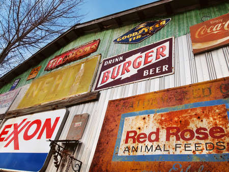 SAVANNAH, GA - FEBRUARY 21, 2015:  A colorful array of vintage advertising signs adorn the outside of an old building at a flea market near Savannah, Georgia, USA.